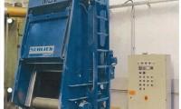 Schlick Muldenband werpstraalmachine (trommelband) met een turbine
